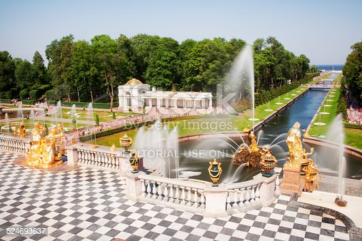 Saint Petersburg, Russia - July 29, 2012: Tourists visiting the Peterhof Palace gardens (built in 18th century) which are a series of palaces and gardens, laid out on the orders of Peter the Great. The palace-ensemble along with the city centre is recognised as a UNESCO World Heritage Site. Upon the bluff's face below the Palace is the Grand Cascade (Bolshoi Kaskad). This and the Grand Palace are the centrepiece of the entire complex.