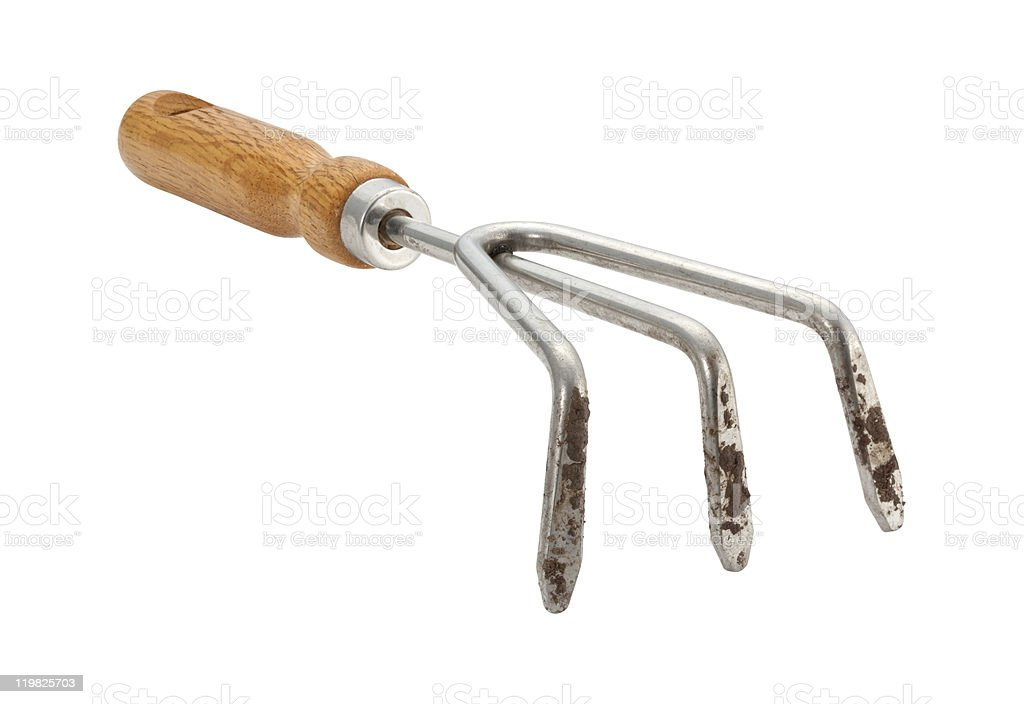 Garden Claw Cultivator with Dirt (clipping path) royalty-free stock photo