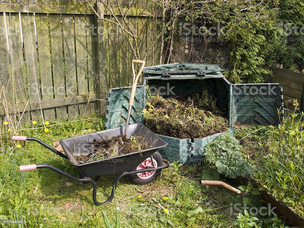 Garden Compost Bin and Wheelbarrow stock photo