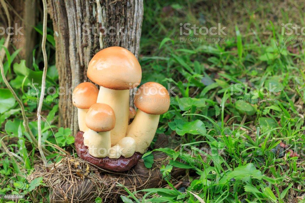 Garden decor - cement mushroom in grass stock photo