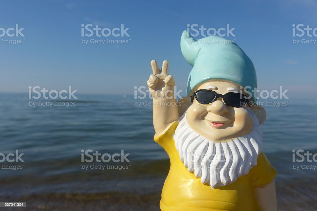Garden dwarf on vacation at sea stock photo