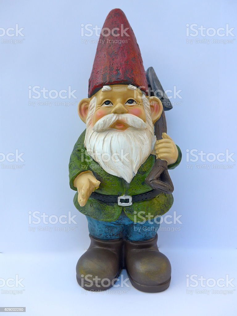 Garden dwarf with red hat against white background stock photo