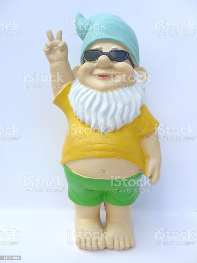 Garden dwarf with sunglasses against white background stock photo