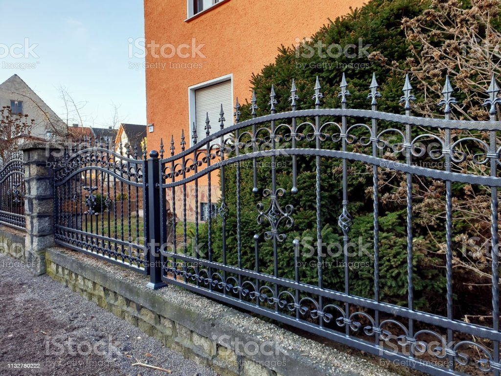Garden Fence In Front Of The House Stock Photo Download Image