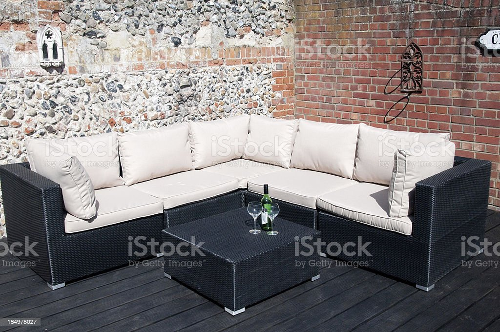 Garden furniture in black rattan royalty-free stock photo