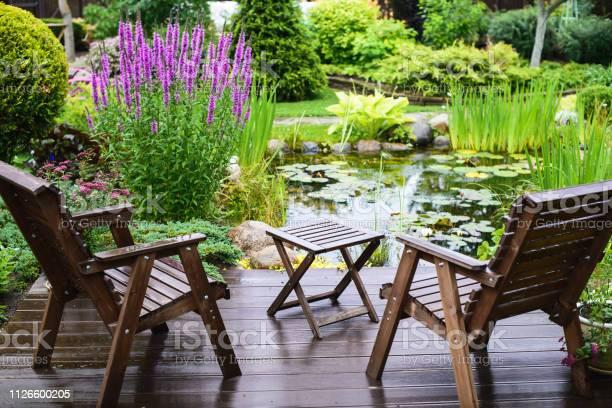 Photo of Garden furniture near the pond