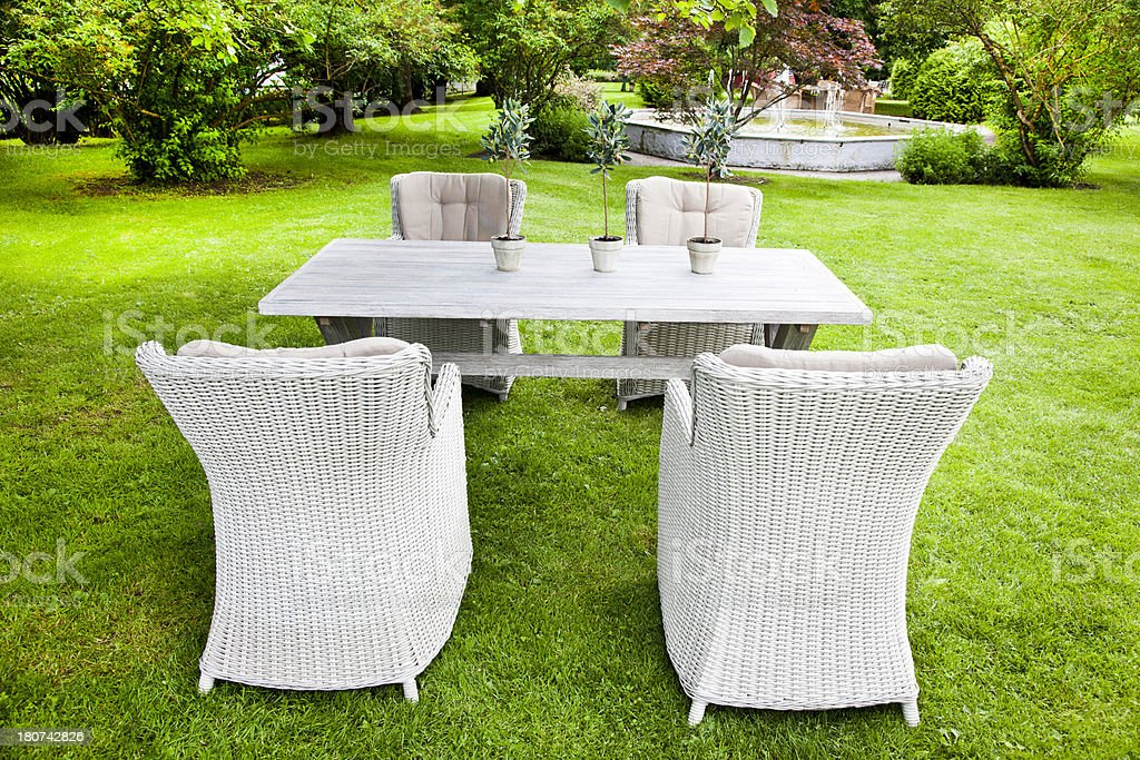 Garden furniture in a backyard garden in the summer