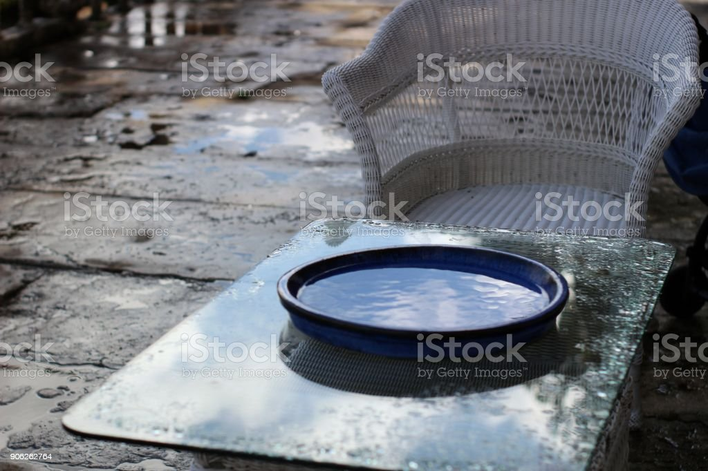 Garden furniture wet by the autumn rain stock photo