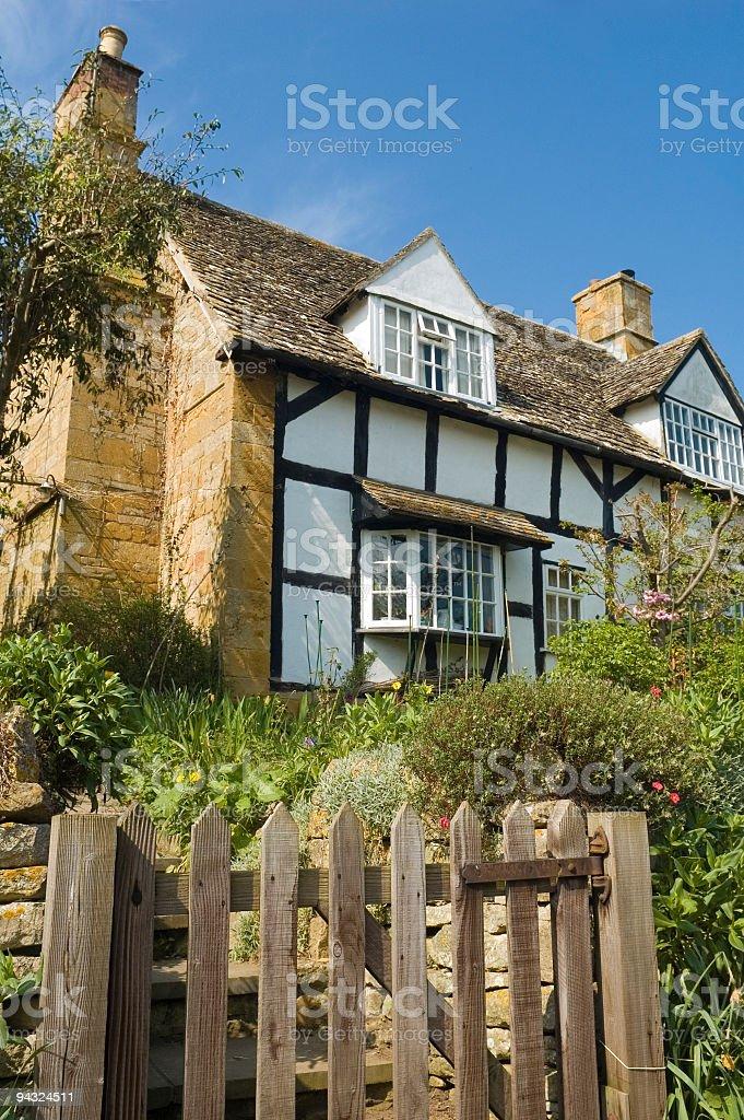 Garden gate to pretty cottage royalty-free stock photo