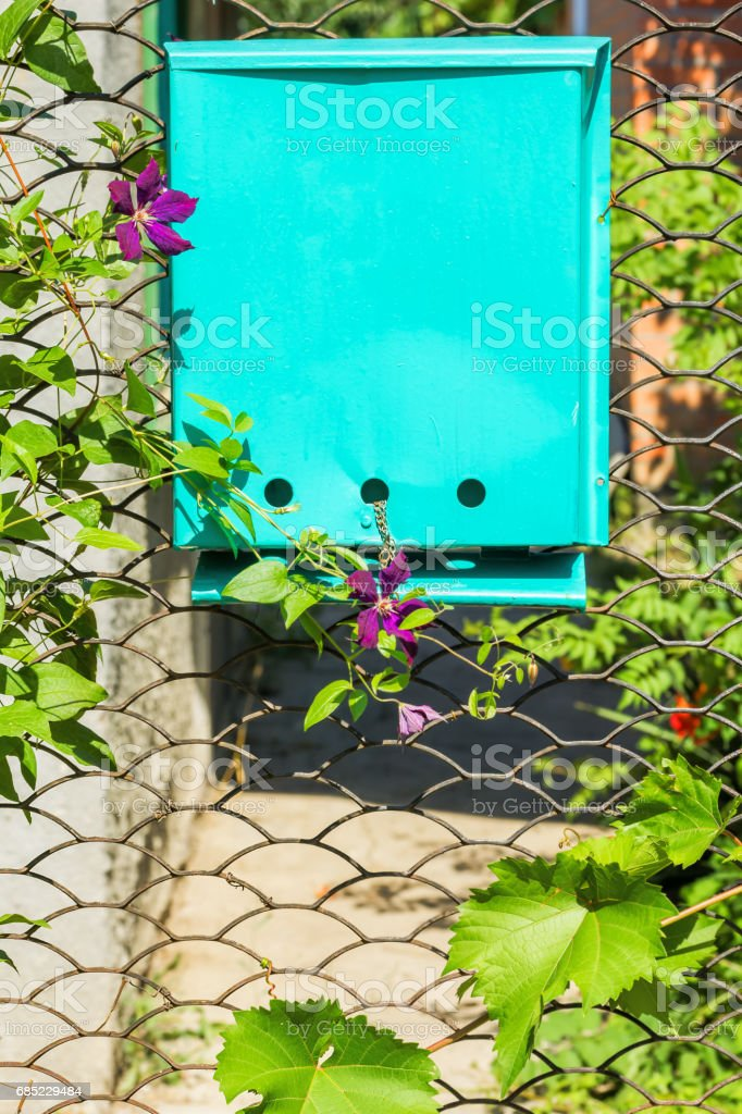 Garden gate with the mailbox on a sunny summer day royalty-free stock photo