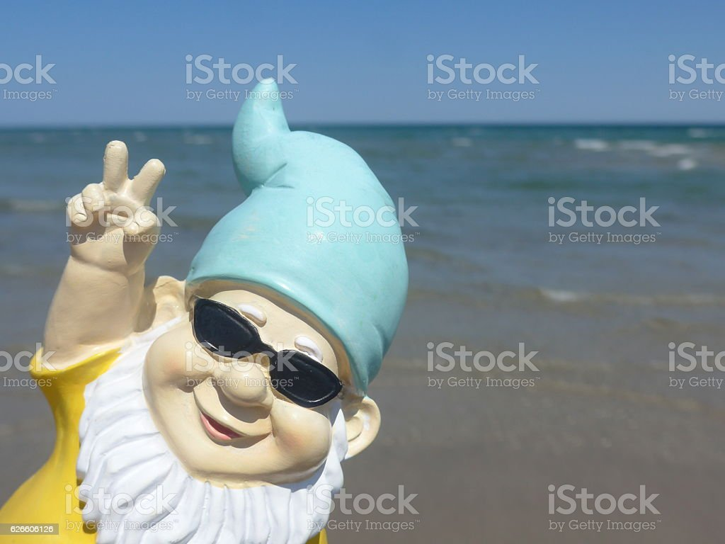 Garden gnome on vacation at sea stock photo
