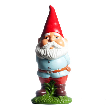 A squared full view of a cute and proud garden gnome, with a red cone hat and a white beard, isolated on white. Ideal for conveying any luck / gardening related concept.