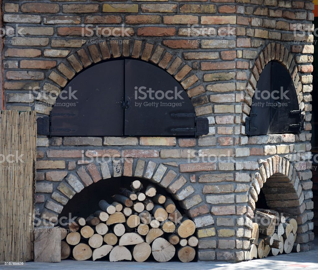Garden grill with stored wood pellets stock photo