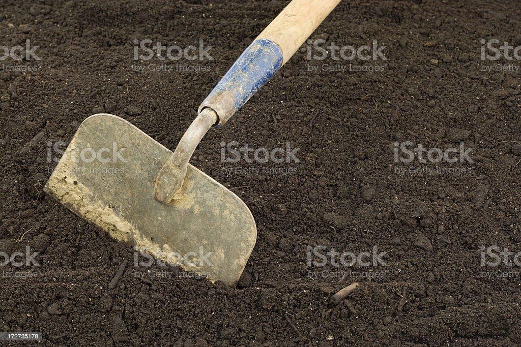 Garden Hoe in Fresh Soil royalty-free stock photo