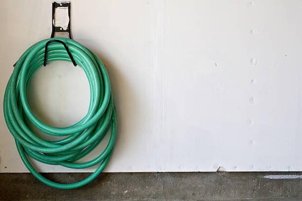 garden hose - garden hose stock pictures, royalty-free photos & images
