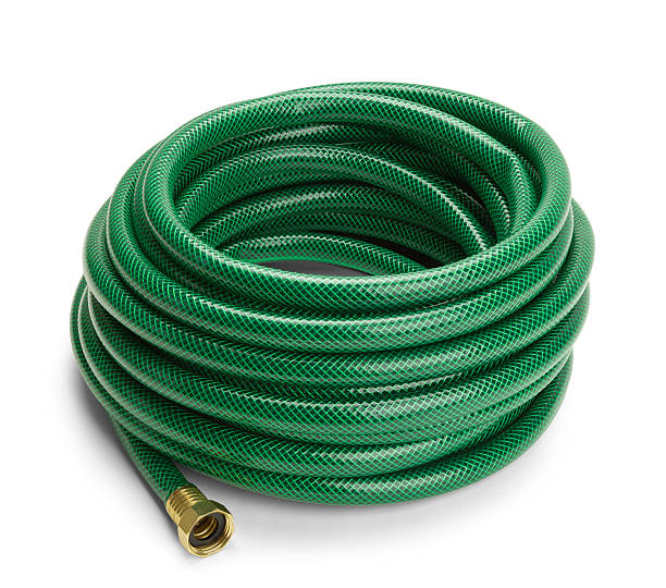 Garden Hose Green Garden Hose Rolled Up Isolated on a White Background. hose stock pictures, royalty-free photos & images