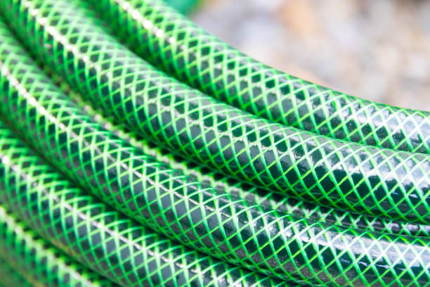garden hose pipe green water close up - garden hose stock pictures, royalty-free photos & images
