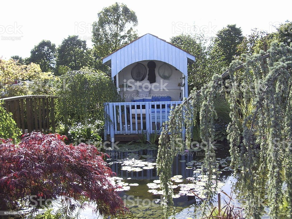 Garden hut on lilly pond royalty-free stock photo