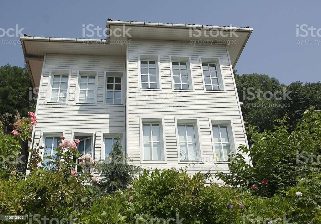 Garden in front of white wooden house, Turkey, Istanbul royalty-free stock photo