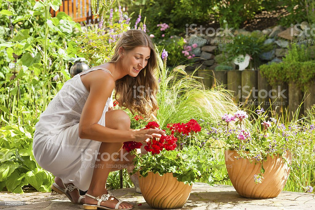 Garden in summer – happy woman with flowers royalty-free stock photo