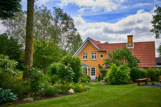 garden in the countryside - denmark stock photos and pictures