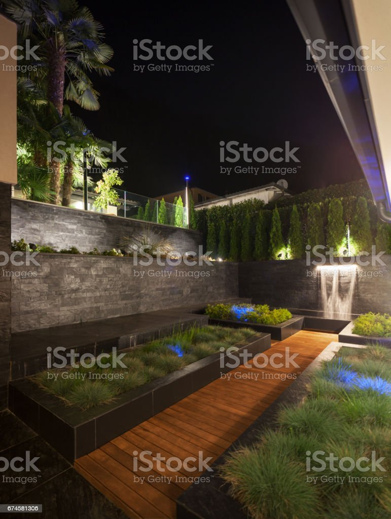 Garden in the yard of luxury villa with fountain stock photo