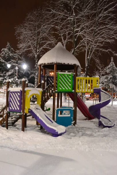 Garden Kid Park in Istanbul during Snowfall at Night-Turkey stock photo