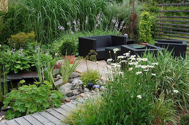 garden lounge - chinaschilf stock-fotos und bilder
