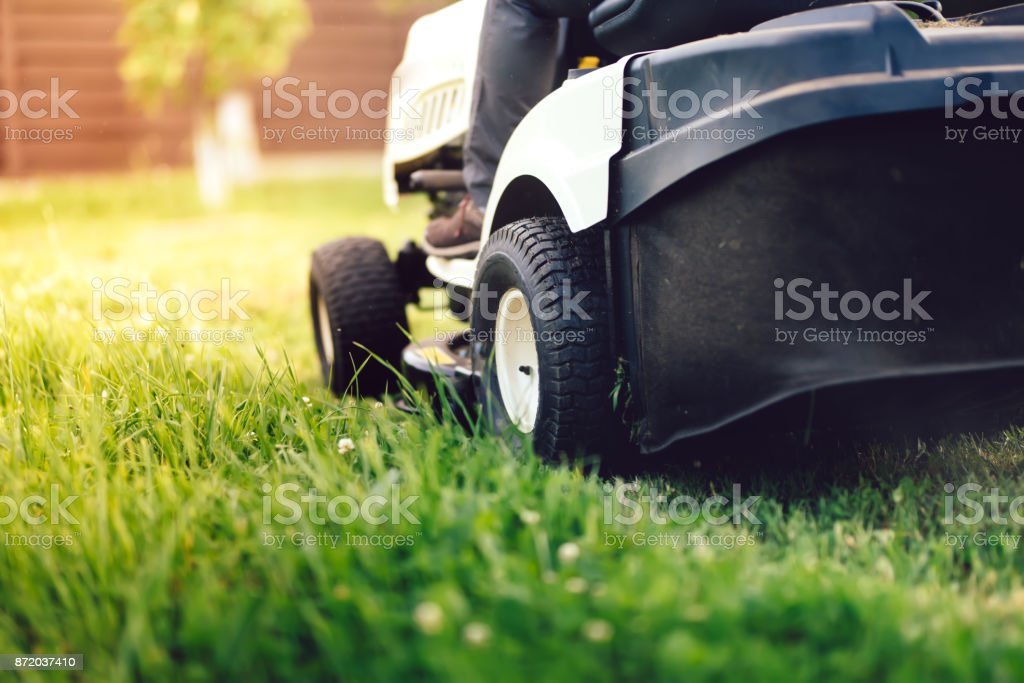 Garden maintenance details - close up view of grass mower stock photo