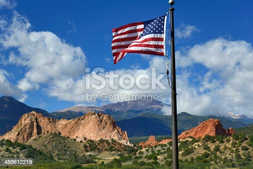 An American flag with the beautiful Garden of the Gods Park in the background in Colorado Springs.