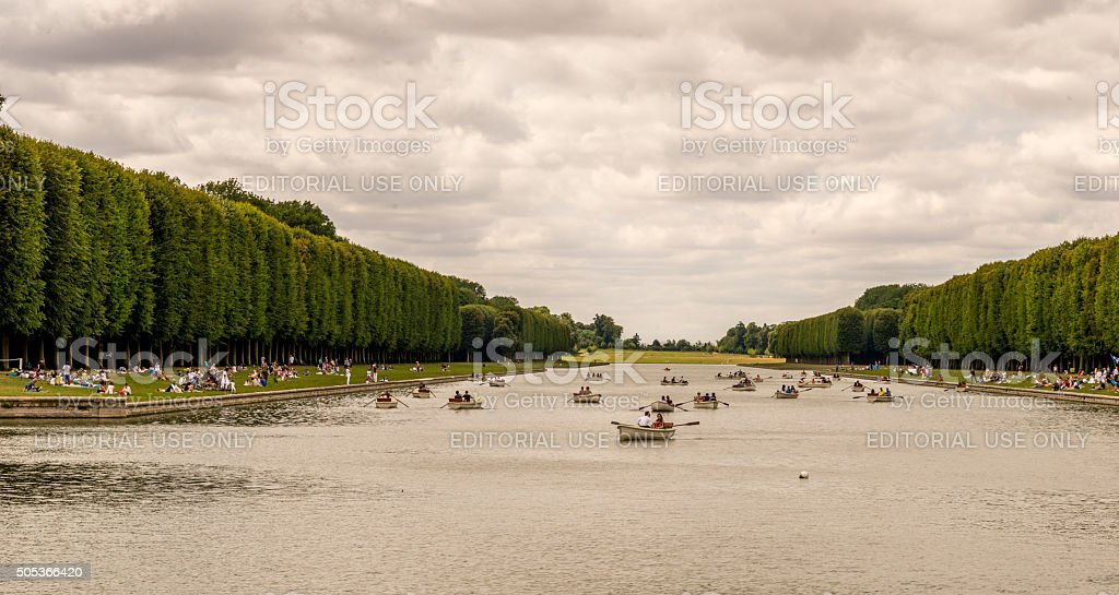 Garden of Versailles lake and boats stock photo
