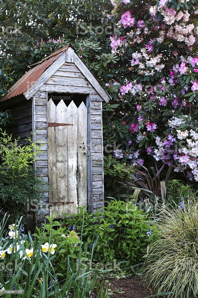 Garden Outhouse stock photo