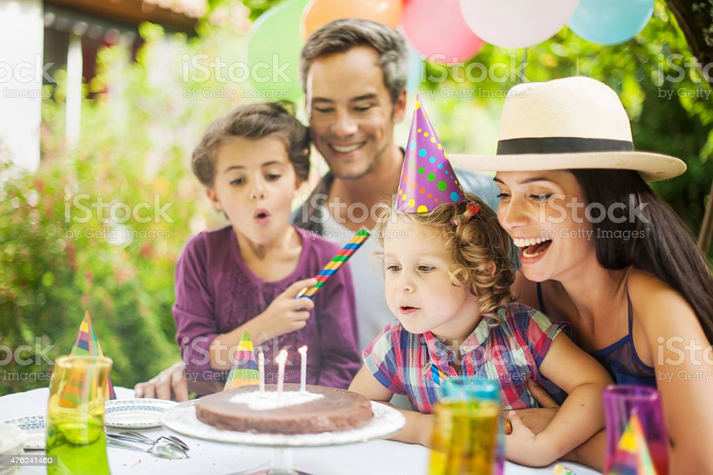 garden party with family for little girl's birthday stock photo