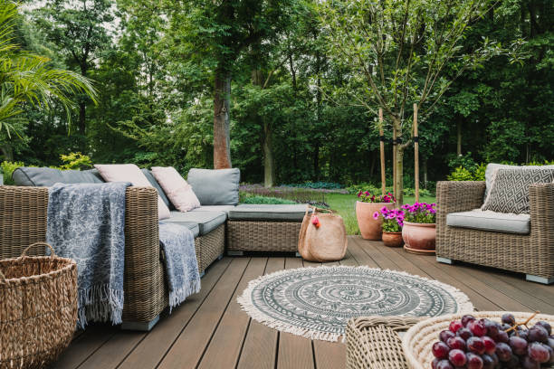 Garden patio decorated with Scandinavian wicker sofa and coffee table stock photo