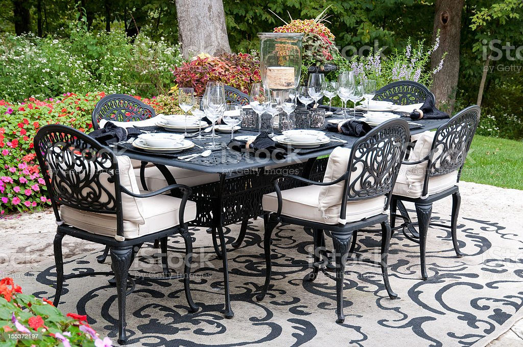 A fabulous table set for dining on the garden patio.