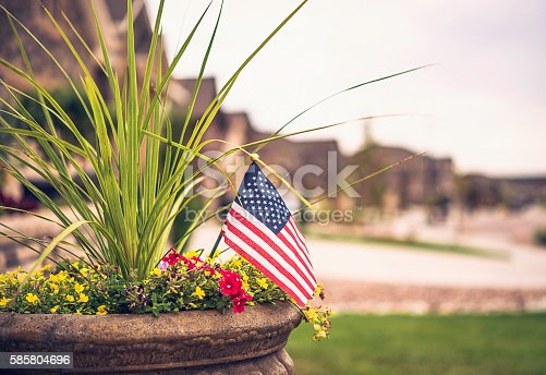 Garden planter with flowers and US flag for American holidays