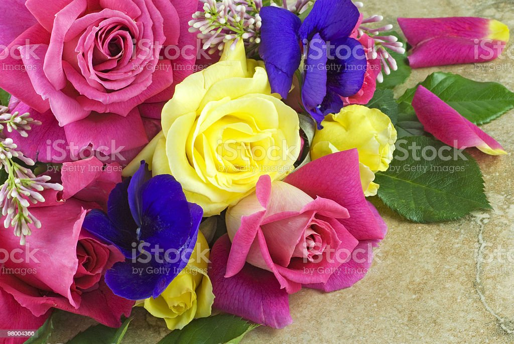 Garden Roses and Pansies on Vintage Background royalty-free stock photo
