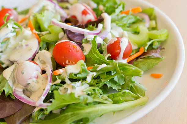 Garden Salad Ranch Fresh organic garden salad with creamy ranch dressing salad dressing stock pictures, royalty-free photos & images