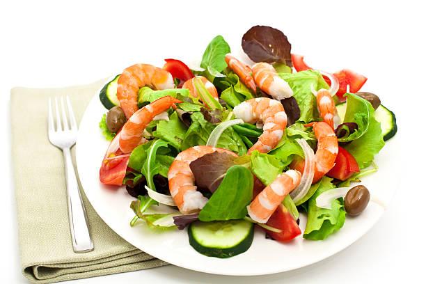 garden salad with shrimps stock photo