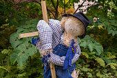 Garden scarecrow dressed in blue Denim.