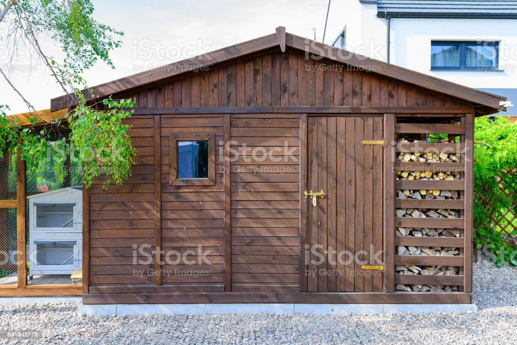 Garden shed exterior in Spring, with woodshed stock photo