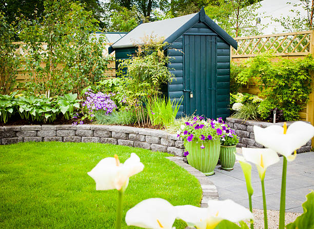 Garden shed in a beautiful green garden Back garden tool shed shed stock pictures, royalty-free photos & images