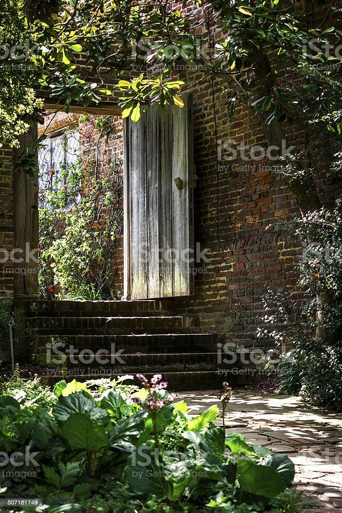 Garden steps to a solid wooden door stock photo