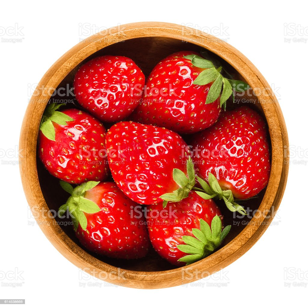 Garden Strawberries in wooden bowl on white background stock photo