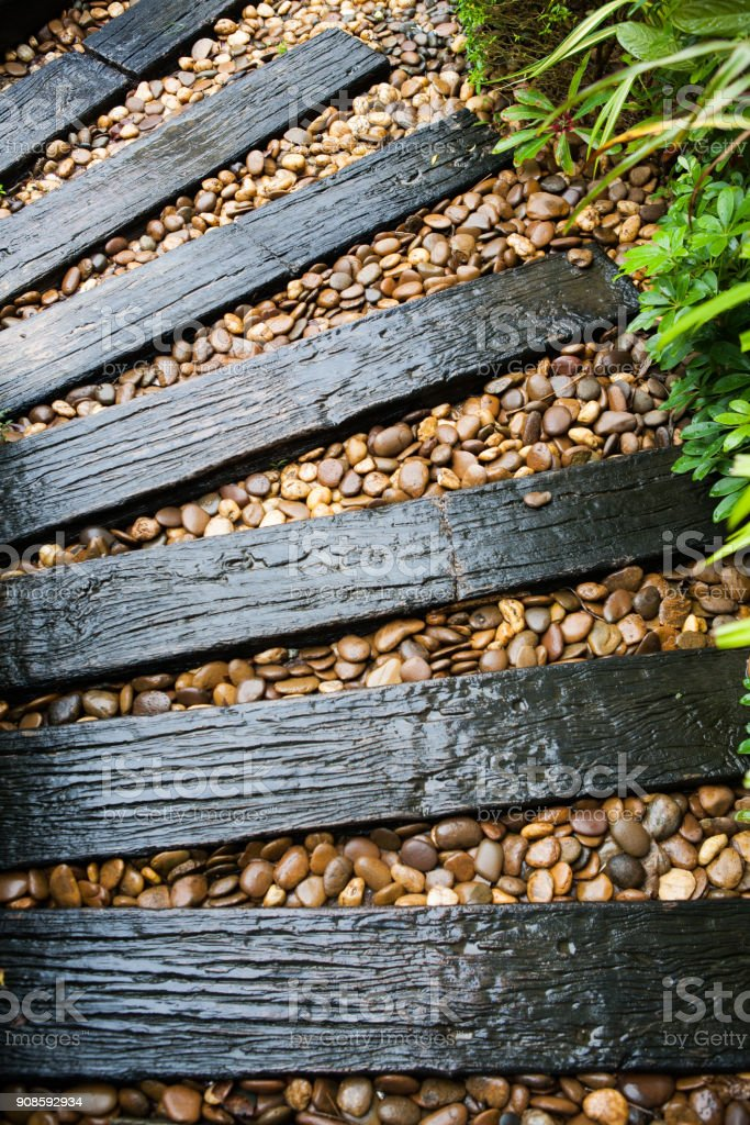 garden structure made out of reclaimed railway sleepers stock photo