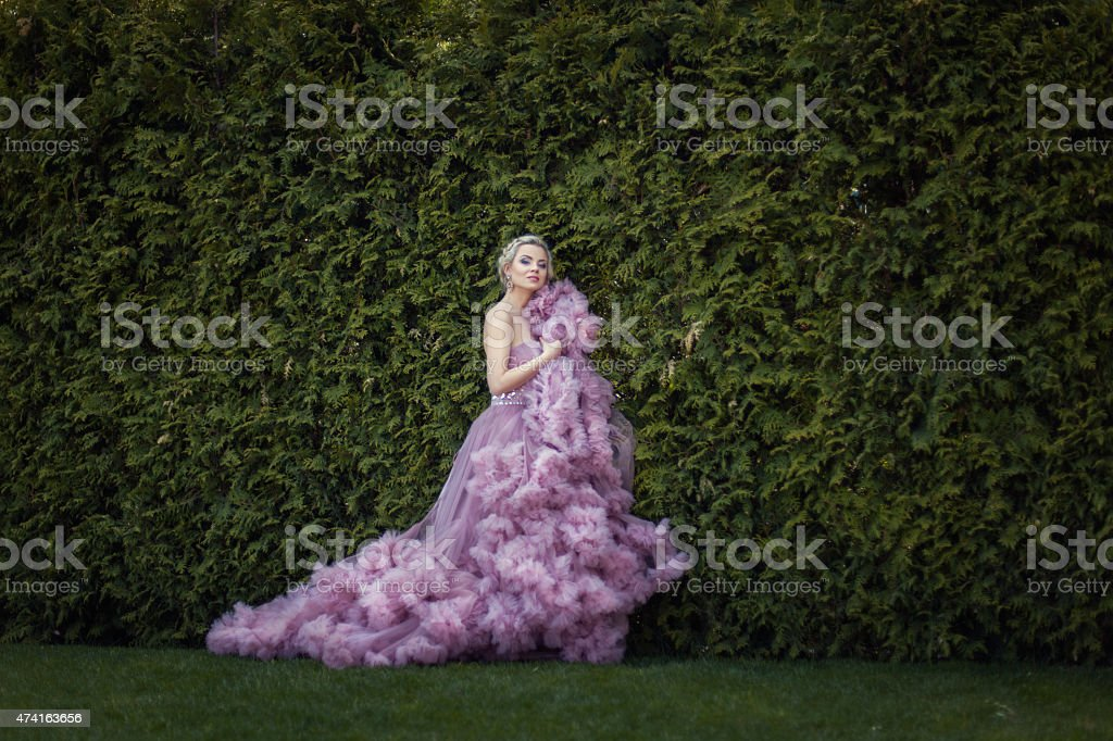 Garden there lovely blonde in a dress. stock photo