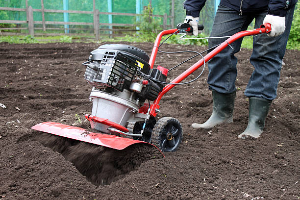 Garden tiller to work Garden tiller to work garden hoe stock pictures, royalty-free photos & images