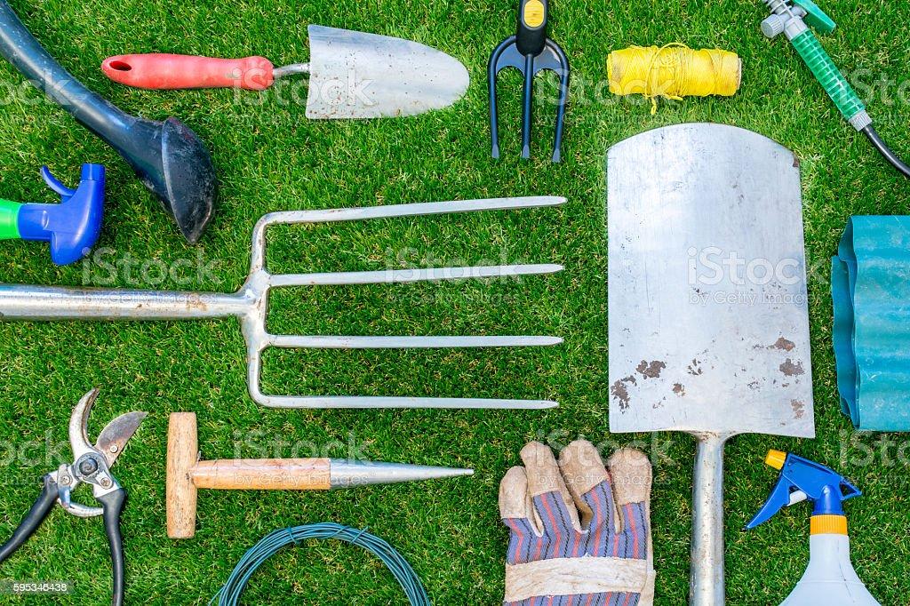 Garden Tools Fork Spade on Grass stock photo