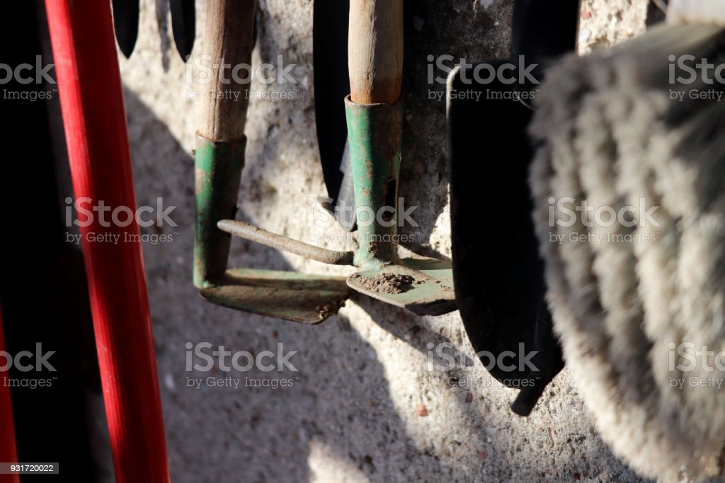 A garden tools hanging on the wall stock photo