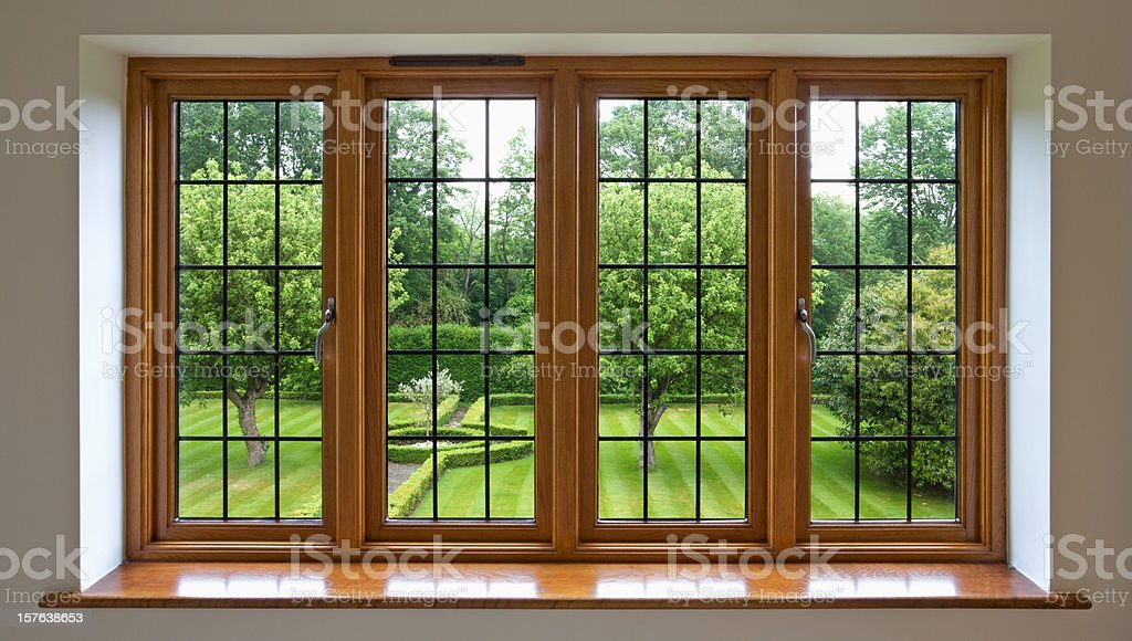 Garden view through leaded glass window royalty-free stock photo
